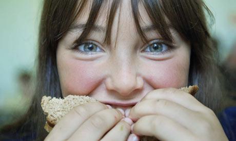 Girl eats sandwich