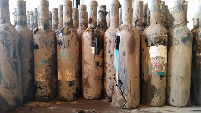 bottiglie vino fango Solopaca