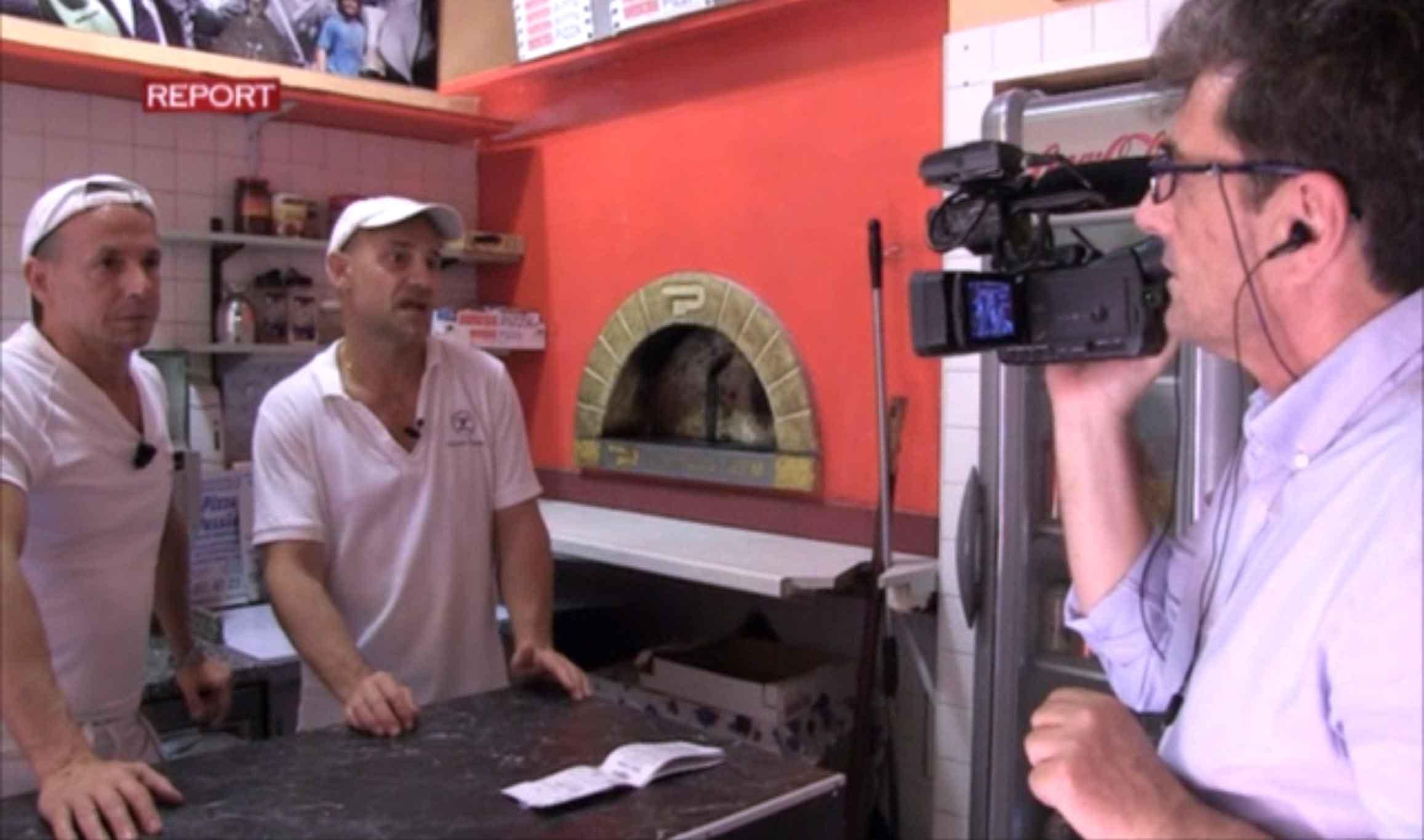 Nero a metà pizza Report