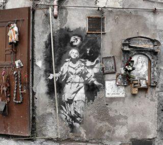 Napoli. La street art di Banksy diventa pubblicità a una pizzeria