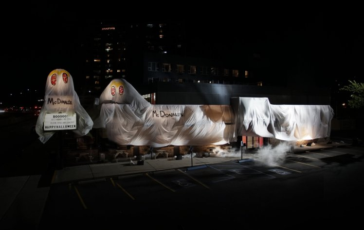 """Fast-food chains love a good publicity stunt. Whether it's Dunkin' Donuts bringing Big Papi and Gronk together for a horribly kitschy music video for an even campier jingle, or when Arby's trolled vegetarians with its totally sparse """"meatless"""" menu, there is always at least one prank or joke to fuel the social media fire. Most recently, one location of Burger King decided to pull what's likely its saltiest stunt to date: """"dressing up"""" like a McDonald's ghost. What troll level is that, you ask? We'd say about 100. The sassy BK outpost in question is in Rego Park, New York. Take a closer look at its costume and tongue-in-cheek message."""