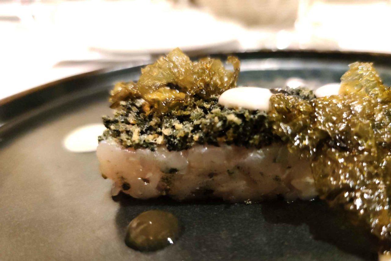 osteria con antipasti di pesce crudo