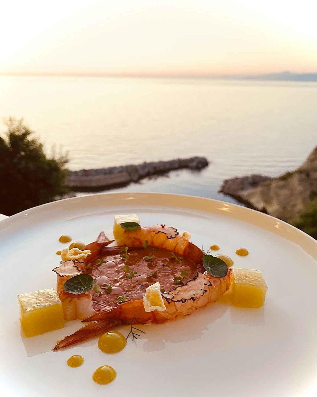 riaperture ristoranti il 26 aprile: piatto di pesce